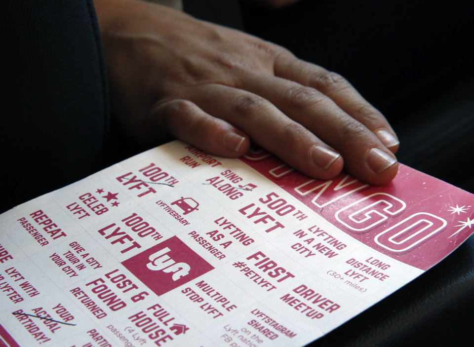 Photo -   A Lyft bingo card is available for riders to play inside a private car driven by a part-time Lyft driver in Denver.  AP Photo   Brennan Linsley -  AP