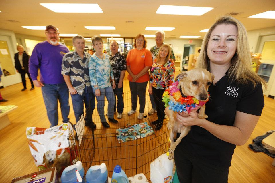 Members of the Central Oklahoma Parrot Head Association pose with Amy Shrodes of the Central Oklahoma Humane Society. Photo By Steve Gooch, The Oklahoman