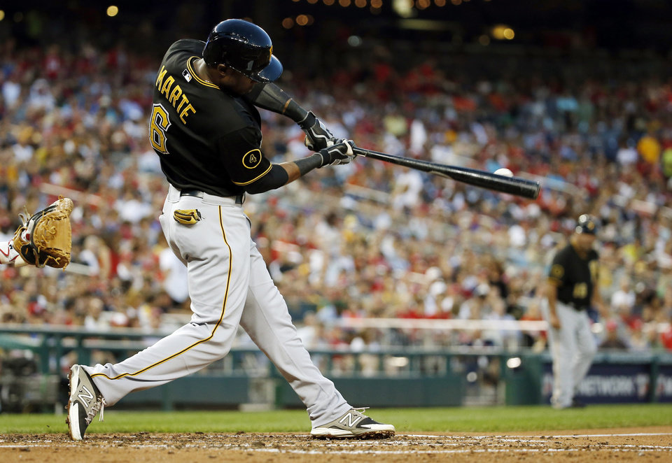 Photo - Pittsburgh Pirates' Starling Marte breaks his bat as he hits an RBI single during the third inning of a baseball game against the Washington Nationals at Nationals Park, Saturday, Aug. 16, 2014, in Washington. (AP Photo/Alex Brandon)