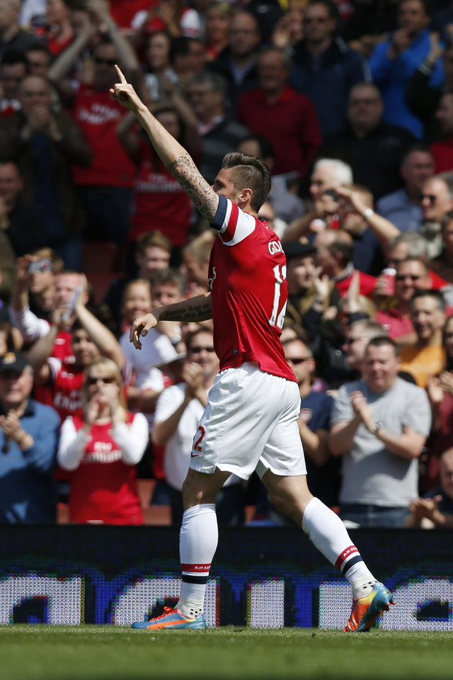 Photo - Arsenal's Olivier Giroud celebrates his goal against West Bromwich Albion during their English Premier League soccer match at Emirates Stadium in London, Sunday, May 4, 2014. (AP Photo/Sang Tan)