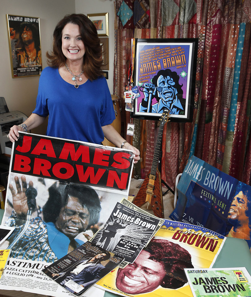 """Photo - Kelly Jarrell Gordon stands with memorabilia from her entertainment career, which included 13 years as a backup singer for James Brown, appearance in the Jackie Brown movie """"The Tuxedo,"""" and a stint as Susan Dey's assistant.  Photo By David McDaniel, The Oklahoman"""