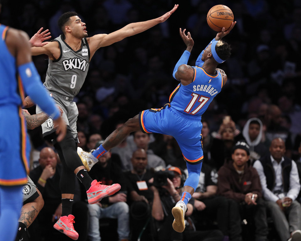 Photo - Brooklyn Nets guard Timothe Luwawu-Cabarrot (9) defends Oklahoma City Thunder guard Dennis Schroder (17) during the second half of an NBA basketball game, Tuesday, Jan. 7, 2020, in New York. The Thunder defeated the Nets 111-103 in overtime. (AP Photo/Kathy Willens)