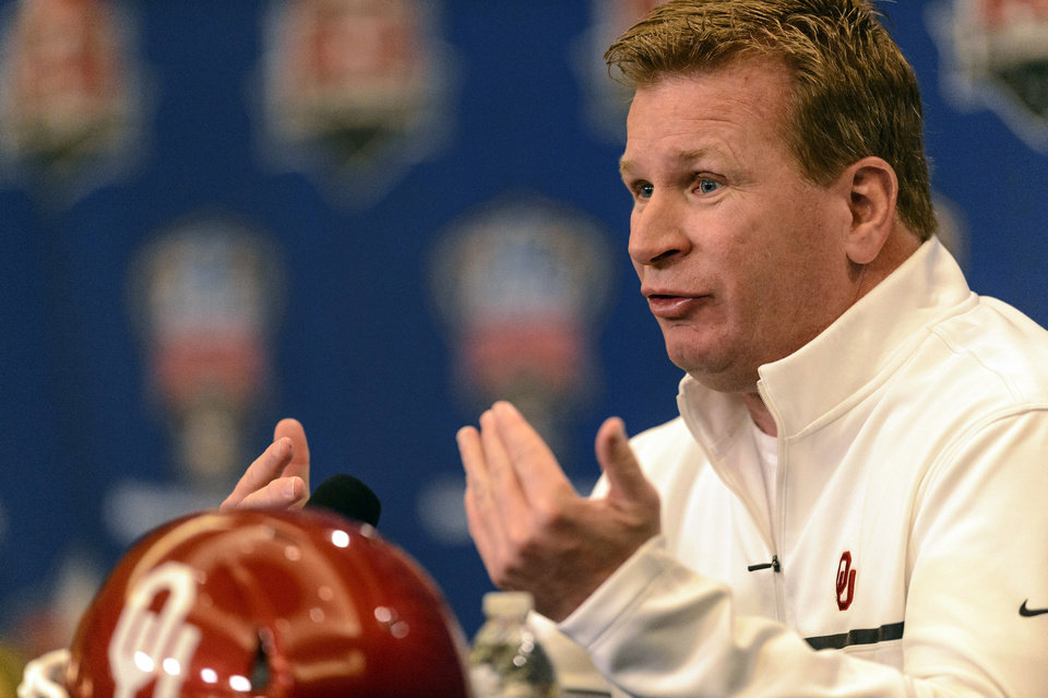 Photo - Oklahoma defensive coordinator Mike Stoops speaks the media during an NCAA college football news conference, Sunday, Dec. 29, 2013, at the New Orleans Marriott Conventions Center in New Orleans. Oklahoma plays Alabama in the Sugar Bowl on Thursday, Jan.  2, 2014.(AP Photo/AL.com Vasha Hunt) MAGS OUT