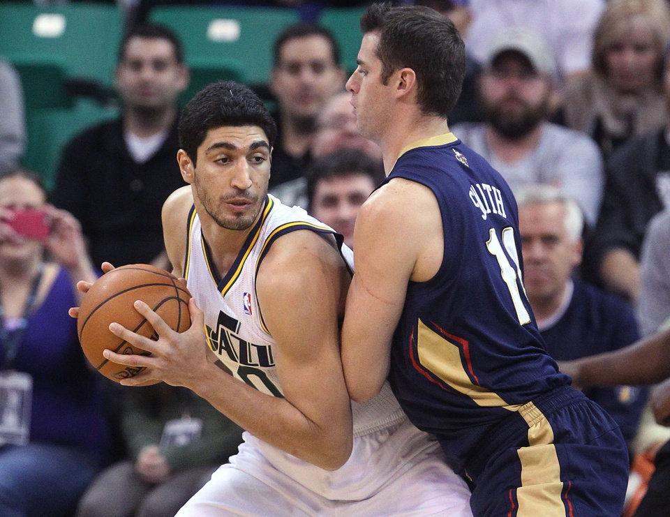 Photo - New Orleans Pelicans' Jason Smith (14) defends Utah Jazz's Enes Kanter, left, during the first quarter of an NBA basketball game Wednesday, Nov. 13, 2013, in Salt Lake City. (AP Photo/Rick Bowmer)