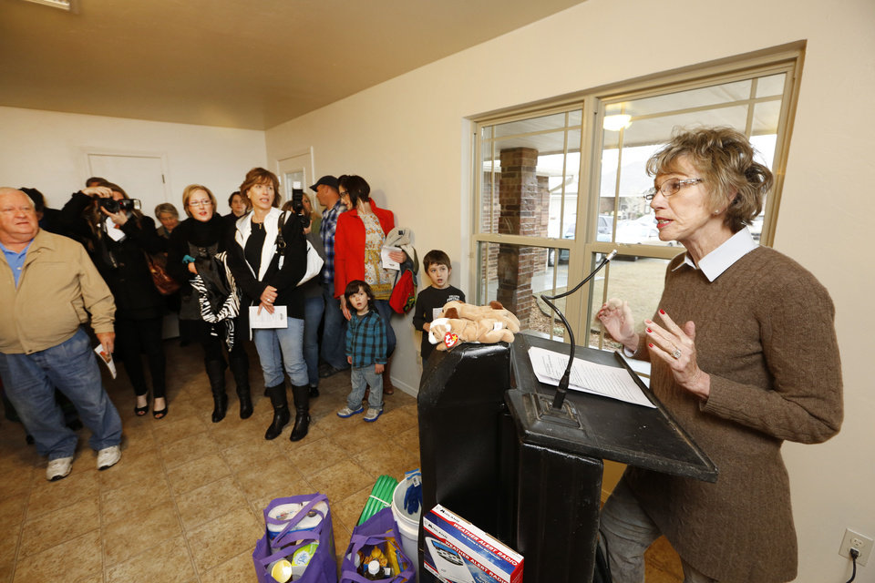 Ann Felton Gilliland, chairman and CEO of Central Oklahoma Habitat for Humanity speaks to guests during the dedication of Habitat's 700th home, in Yukon, in April. <strong>Steve Gooch - The Oklahoman</strong>