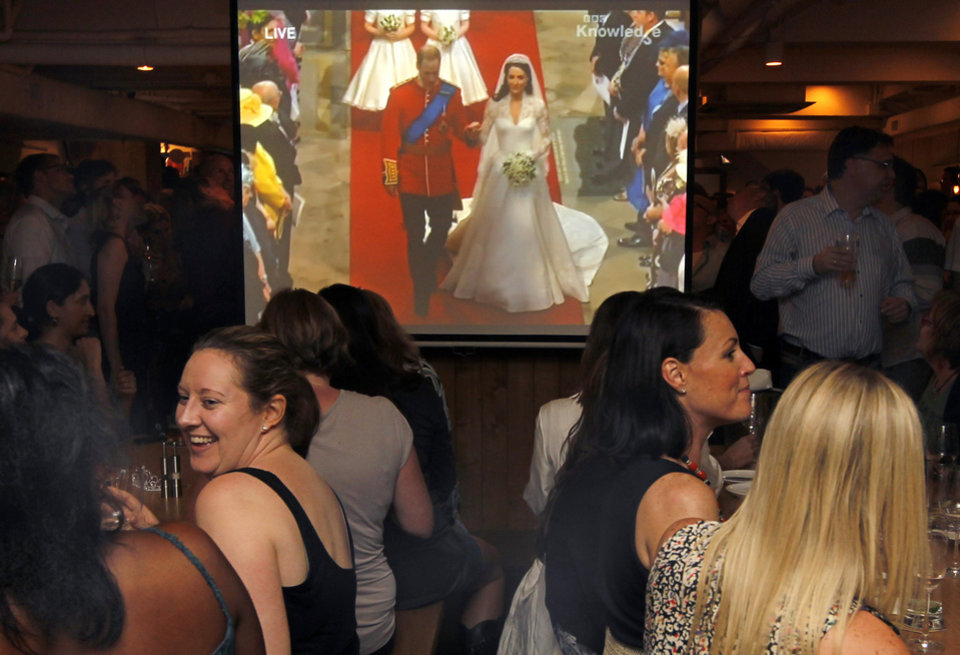 Photo - British nationals in Hong Kong watch the Royal Wedding by Prince William and Kate Middleton on TV during a party at a pub in Hong Kong Friday, April 29, 2011. (AP Photo/Vincent Yu) ORG XMIT: XVY107