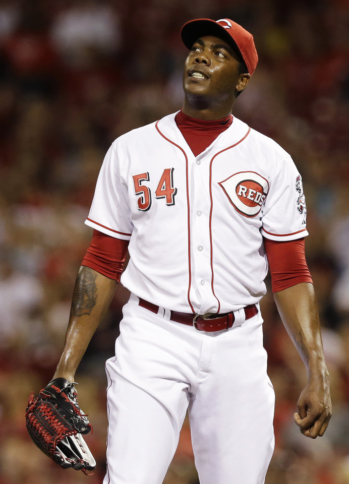 Photo - Cincinnati Reds relief pitcher Aroldis Chapman watches a solo home run by San Diego Padres' Chase Headley in the ninth inning of a baseball game, Tuesday, May 13, 2014, in Cincinnati. San Diego won 2-1. (AP Photo)