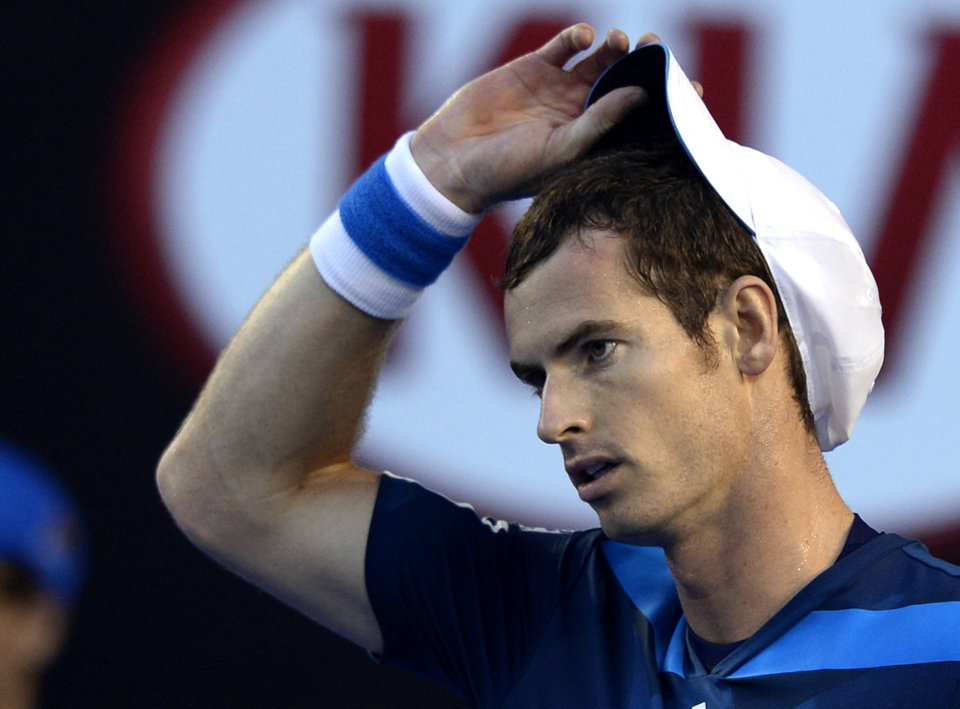 Photo - Andy Murray of Britain adjusts his cap as he plays Roger Federer of Switzerland during their quarterfinal at the Australian Open tennis championship in Melbourne, Australia, Wednesday, Jan. 22, 2014.(AP Photo/Andrew Brownbill)