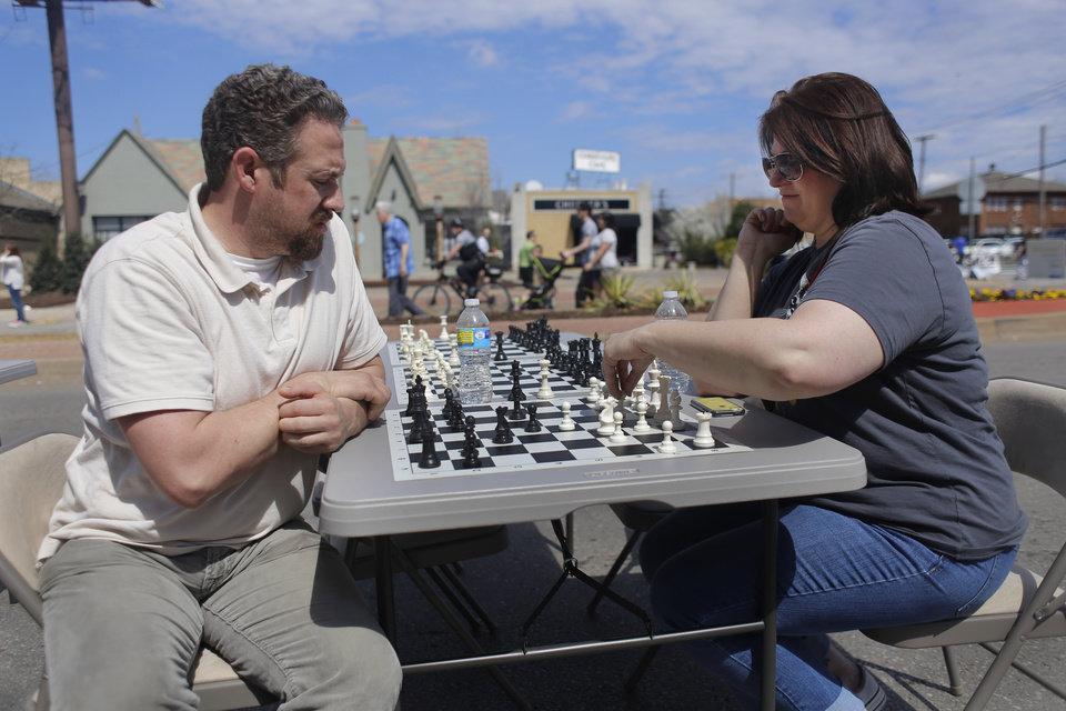 Photo - Brad Stiles and Kate Wolf enjoy a game of chess at Open Streets OKC, along NW 23rd Street between Robinson and Western, Sunday, March 22, 2015. Photo by Doug Hoke, The Oklahoman