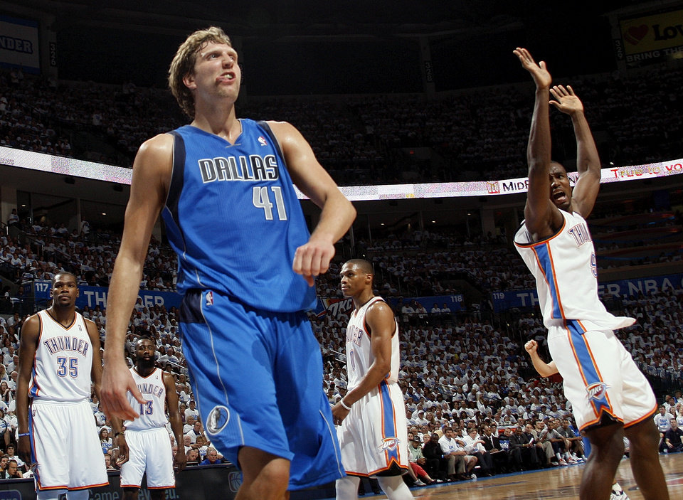 Dallas' Dirk Nowitzki (41) reacts after making a shot and being fouled by Oklahoma City's Serge Ibaka (9), right, during Game 2 of the first round in the NBA basketball  playoffs between the Oklahoma City Thunder and the Dallas Mavericks at Chesapeake Energy Arena in Oklahoma City, Monday, April 30, 2012. From left in the background are Kevin Durant (35), James Harden (13) and Russell Westbrook (0). Photo by Nate Billings, The Oklahoman