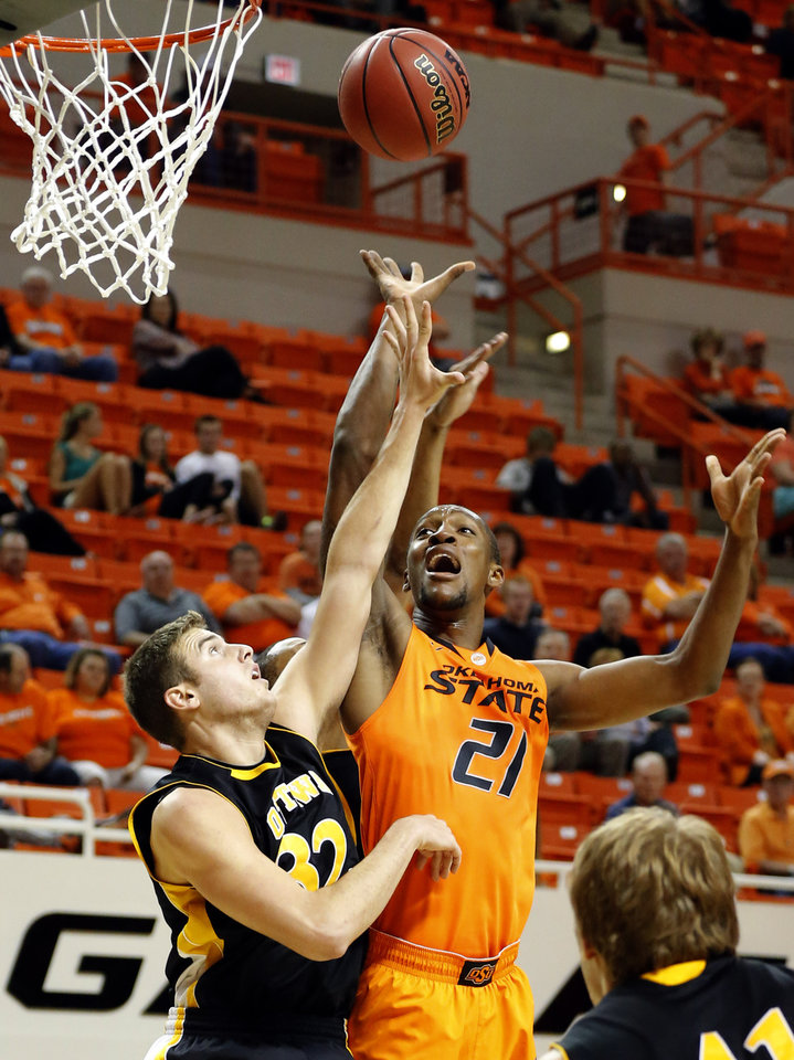 Oklahoma State\'s Kamari Muphy shoots over Ottawa\'s Stephen Feighny during the college basketball game between Oklahoma State University and Ottawa (Kan.) at Gallagher-Iba Arena in Stillwater, Okla., Thursday, Nov. 1, 2012. (AP Photo/The Oklahoman, Sarah Phipps)
