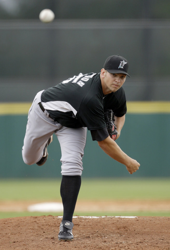 Photo - Florida Marlins pitcher Josh Johnson throws to the Houston Astros during the second inning of a spring training baseball game, Monday, March 23, 2009, in Kissimmee, Fla. (AP Photo/Rob Carr) ORG XMIT: FLRC106