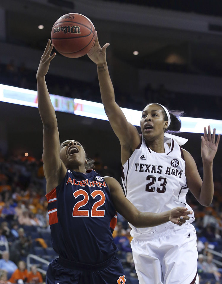 Photo - Auburn guard Kiani Parker (22) goes up for a basket against Texas A&M center Rachel Mitchell (23) during the first half in an NCAA college basketball game in the quarterfinals of the Southeastern Conference women's tournament, Friday, March 7, 2014, in Duluth, Ga. (AP Photo/Jason Getz)