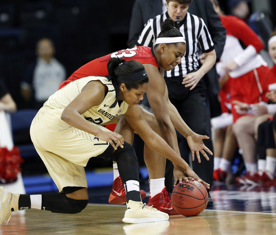 Photo - Vanderbilt guard Morgan Batey, front, and Georgia forward Halle Washington fight for the ball in the first half of a second-round women's Southeastern Conference tournament NCAA college basketball game Thursday, March 6, 2014, in Duluth, Ga. (AP Photo/John Bazemore)