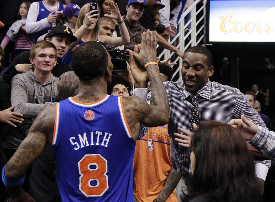 Photo - New York Knicks' Amare Stoudemire celebrates with J.R. Smith after Smith hit the game-winning shot against the Phoenix Suns after an NBA basketball game, Wednesday, Dec. 26, 2012, in Phoenix. The Knicks won 99-97. (AP Photo/Matt York)