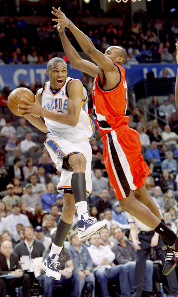 Oklahoma City's Russell Westbrook goes by Portland's Travis Outlaw during the NBA basketball game between the Oklahoma City Thunder and the Portland Trail Blazers at the Ford Center in Oklahoma City, Friday, April 3, 2009.   Photo by Bryan Terry, The Oklahoman ORG XMIT: KOD