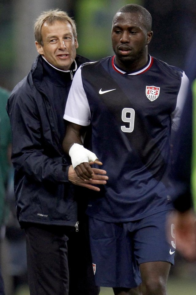 Photo -   FILE - In this Feb. 29, 2012, file photo, United States forward Jozy Altidore (9) is congratulated by head coach Jurgen Klinsmann as he leaves the field during a friendly soccer match against Italy in Genoa, Italy. Altidore was dropped Monday, Oct. 8, from the U.S. roster for critical World Cup qualifiers. Klinsmann was critical in an espn.com interview published Sept. 28, saying,
