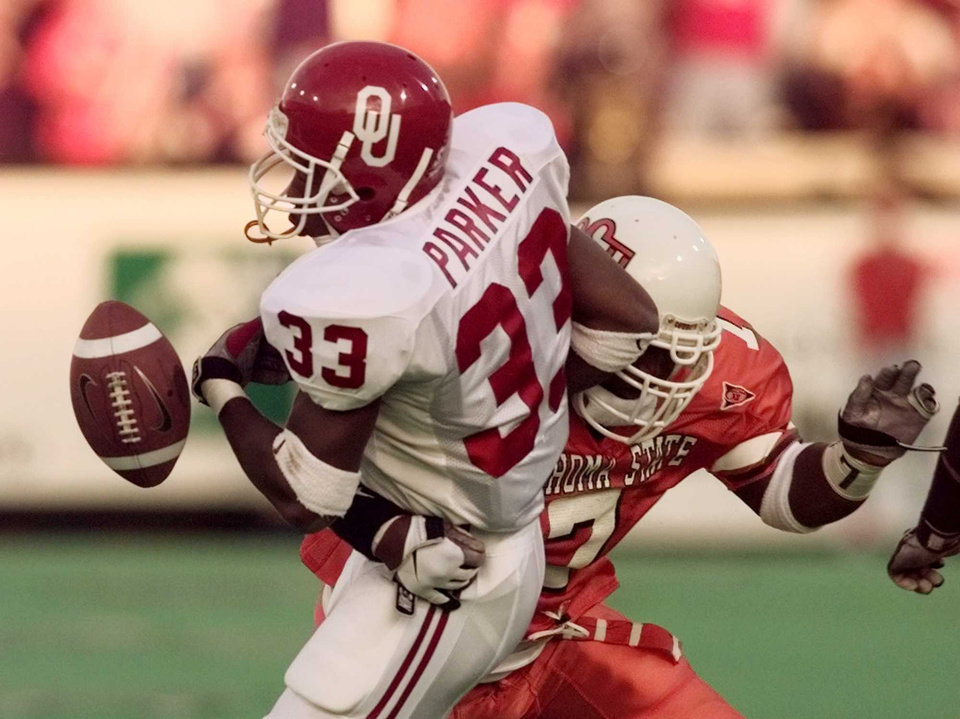 OSU's Kenyatta Wright causes De'Mond Parker to fumble during the Bedlam college football game in Stillwater, Okla. Oct. 24, 1998. Photo by Jim Beckel, The Oklahoman