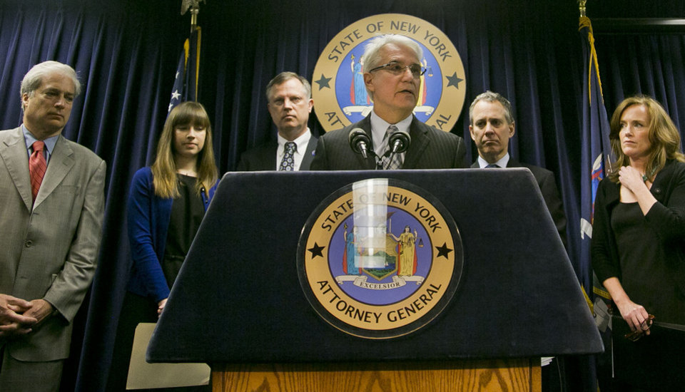 Photo - Citizens Crime Commission of New York president Richard Aborn, far left, Annie Palazzolo, second from left, and her father Paul Boke, third from left, New York Attorney General Eric Schneiderman, second from right and Nassau County, N.Y. Distrct Attorney Kathleen Rice, far right, listens as  San Francisco District Attorney George Gascon speaks during a press conference on Thursday, June 13, 2013, in New York.   The group announced the launch of what they call the