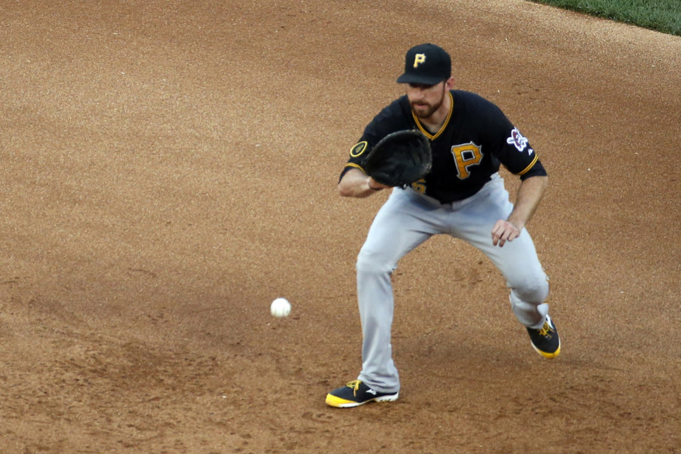 Photo - Pittsburgh Pirates first baseman Ike Davis fields a ball hit by Washington Nationals' Doug Fister who was out at first base on the play during the fifth inning of a baseball game at Nationals Park, Sunday, Aug. 17, 2014, in Washington. (AP Photo/Alex Brandon)