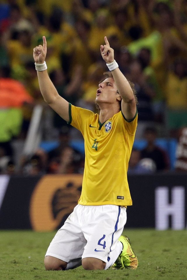Photo - Brazil's David Luiz celebrates at the end of the World Cup quarterfinal soccer match between Brazil and Colombia at the Arena Castelao in Fortaleza, Brazil, Friday, July 4, 2014. Brazil won the match 2-1. (AP Photo/Felipe Dana)