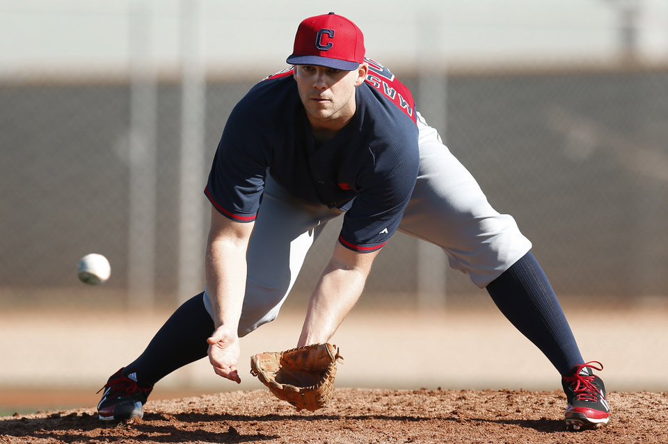 Photo - Cleveland Indians pitcher Justin Masterson fields a ground ball during spring training baseball practice in Goodyear, Ariz., Thursday, Feb. 13, 2014. (AP Photo/Paul Sancya)