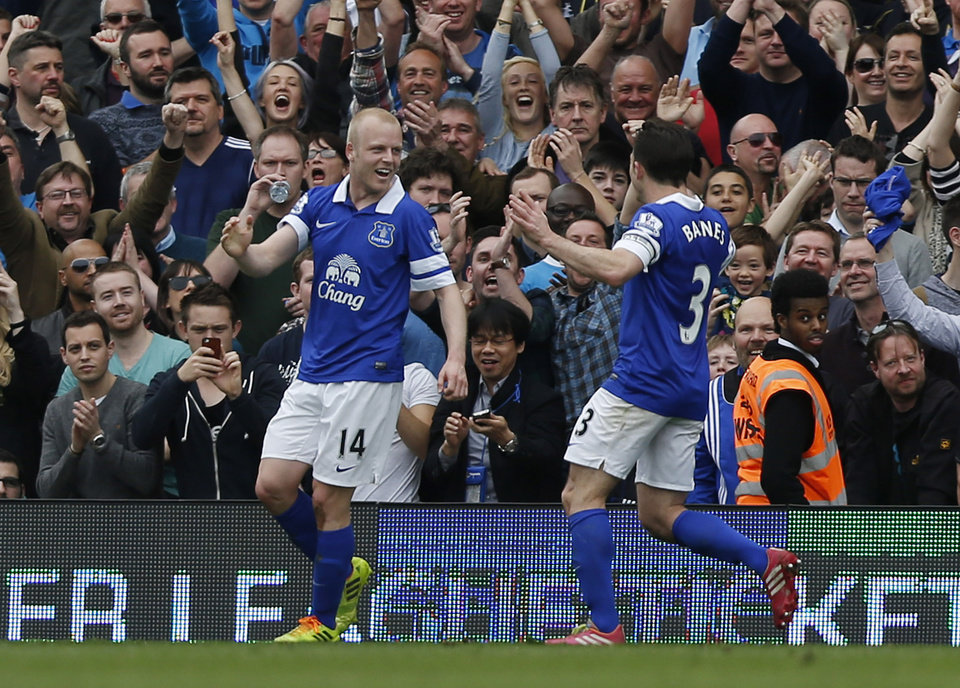 Photo - Everton's Steven Naismith, left, celebrates his second goal against Fulham with teammate Leighton Bains during their English Premier League soccer match at Craven Cottage, London, Sunday, March 30, 2014. (AP Photo/Sang Tan)