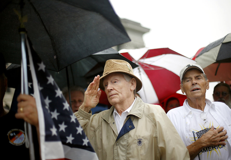 Melvin Gragg, of Edmond salutes during the National Anthem as he watches a Health Care Reform rally on the north side of the State Capitol in Oklahoma City on Sunday, Sept. 13, 2009.  By John Clanton, The Oklahoman