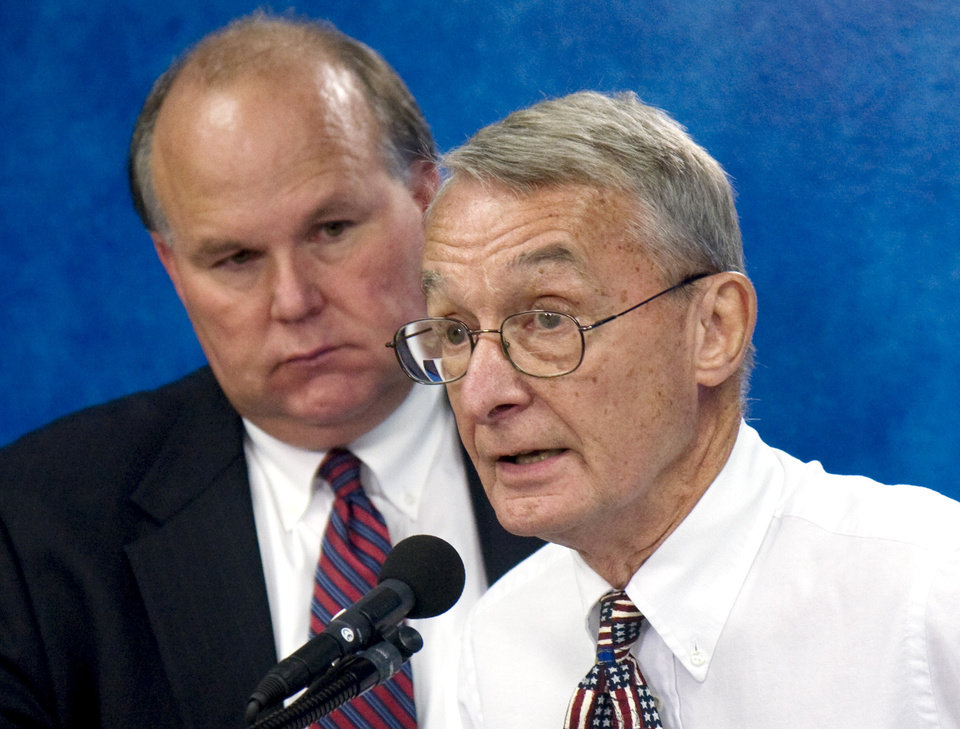 Photo - Oklahoma Republican Party Chairman Gary Jones, left, and Chairman of the Oklahoma Democratic Party Ivan Holmes, right, answer questions together during a press conference at the Capitol Thursday, Sept. 18, 2008. Holmes has recently accused Gov. Mary Fallin of bullying state educators. Photo by Doug Hoke, The Oklahoman
