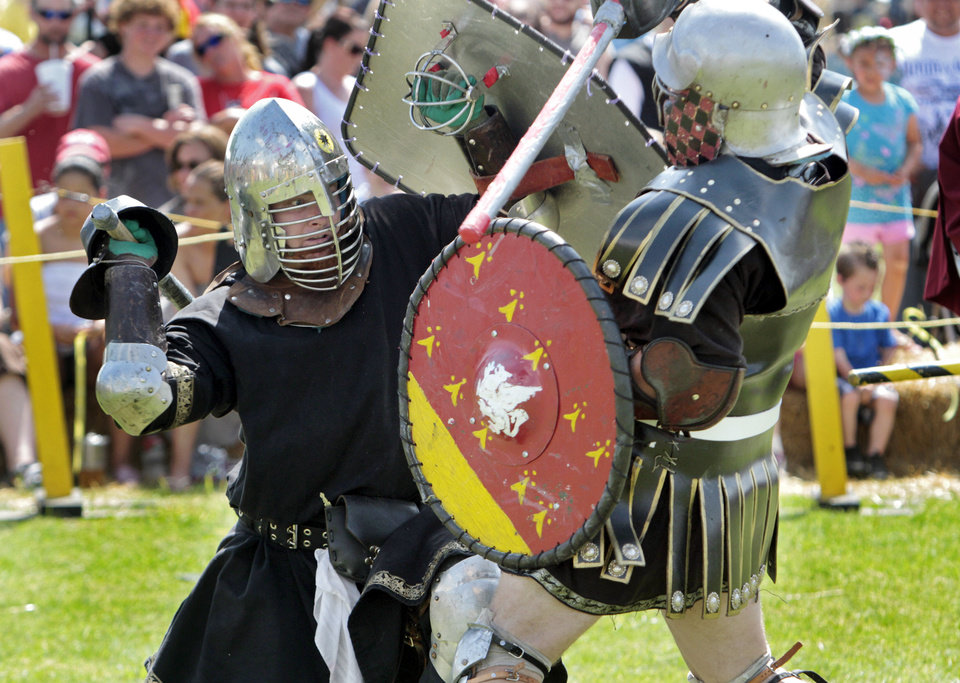 Photo - Knights battle in the arena during the Medieval Fair on Saturday, March 31, 2012, in Norman, Okla.  Photo by Steve Sisney, The Oklahoman