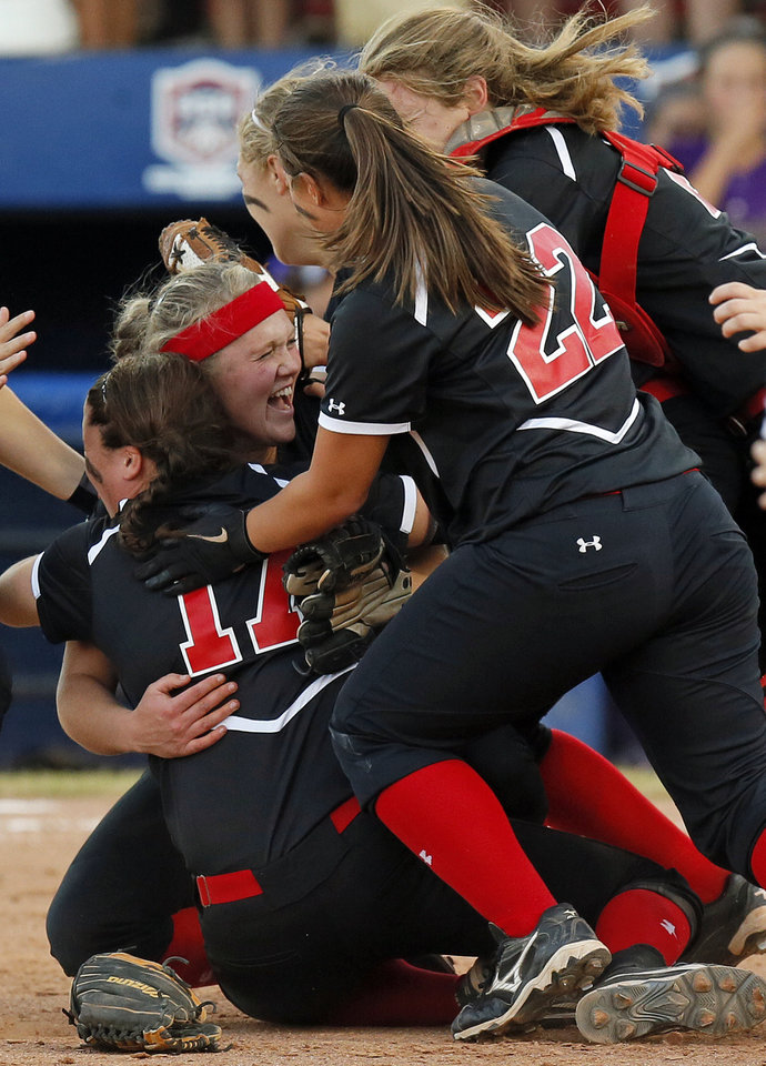 Grove celebrates after winning the 5A state championship fast-pitch softball game against Chickasha at ASA Hall of Fame Stadium in Oklahoma City, Monday, Oct. 15, 2012. Grove won, 3-2. Photo by Nate Billings, The Oklahoman