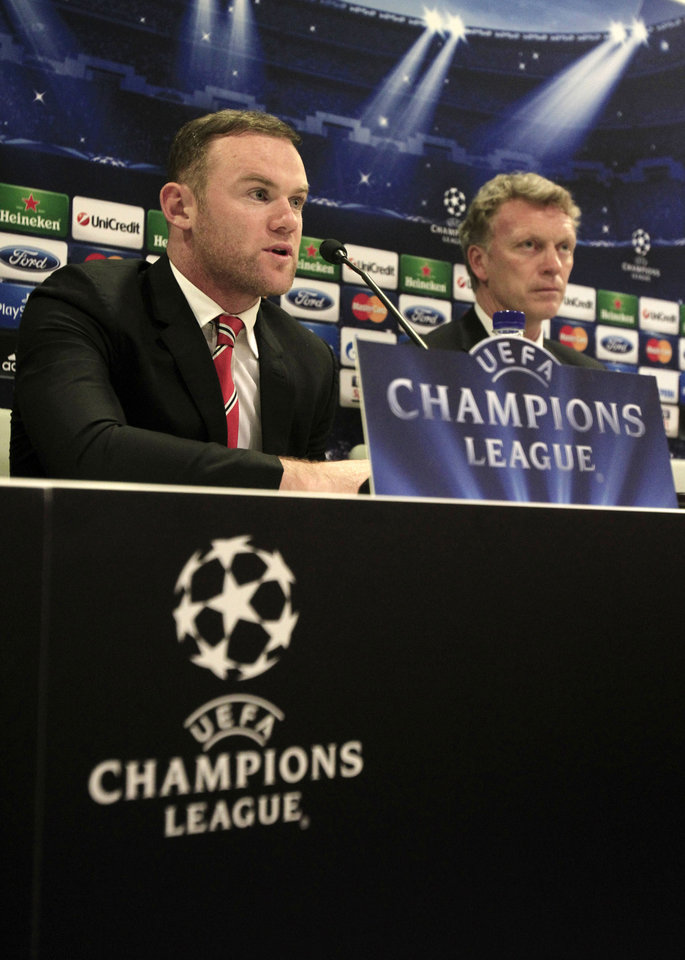 Photo - Manchester United's player Wayne Rooney, left, and coach David Moyes attend a news conference at Georgios Karaiskakis stadium, in Piraeus port, near Athens, on Monday, Feb. 24, 2014. Manchester United will play against Olympiakos in the Champions League's round of 16 on Tuesday. (AP Photo/Thanassis Stavrakis)