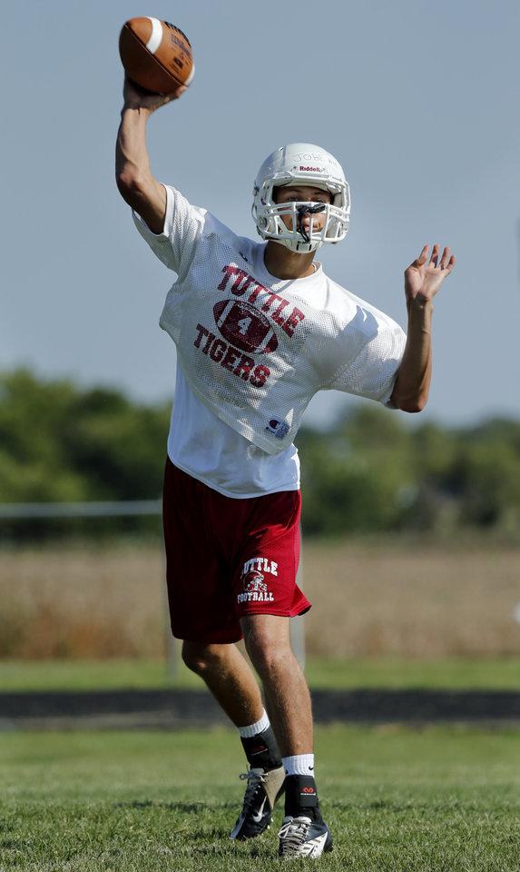 Photo - Quarterback Jett Jobe practices on Tuesday, Aug. 12, 2014 in Tuttle, Okla. Photo by Steve Sisney, The Oklahoman