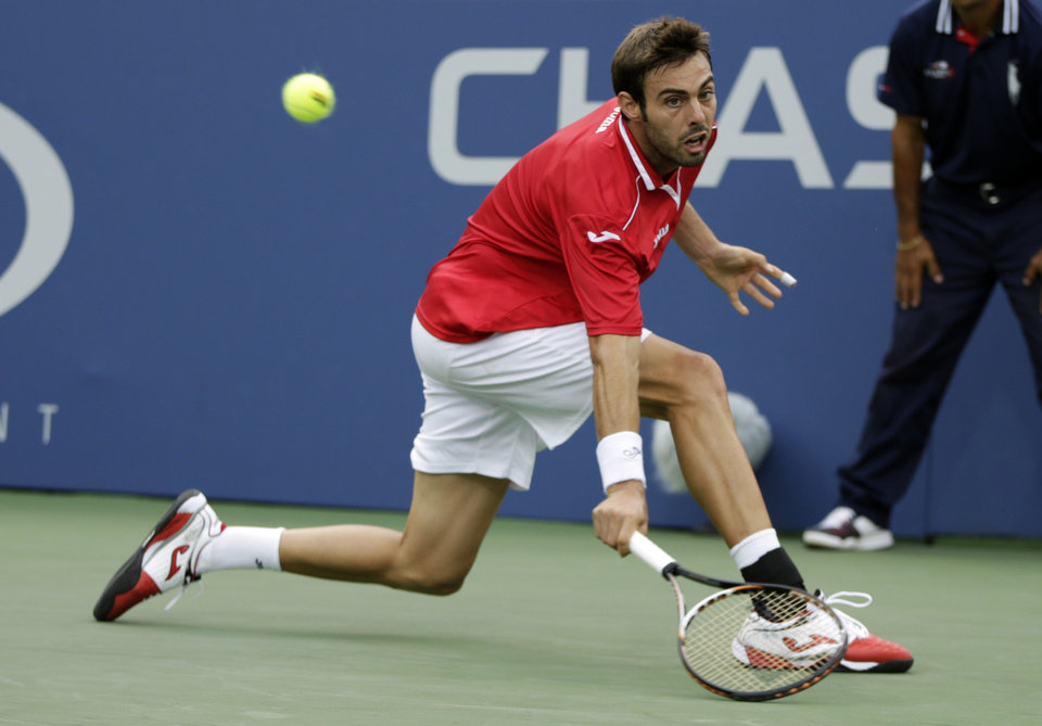 Photo - Marcel Granollers of Spain returns a shot against Tim Smyczek during the third round of the 2013 U.S. Open tennis tournament, Sunday, Sept. 1, 2013, in New York. (AP Photo/Kathy Willens)