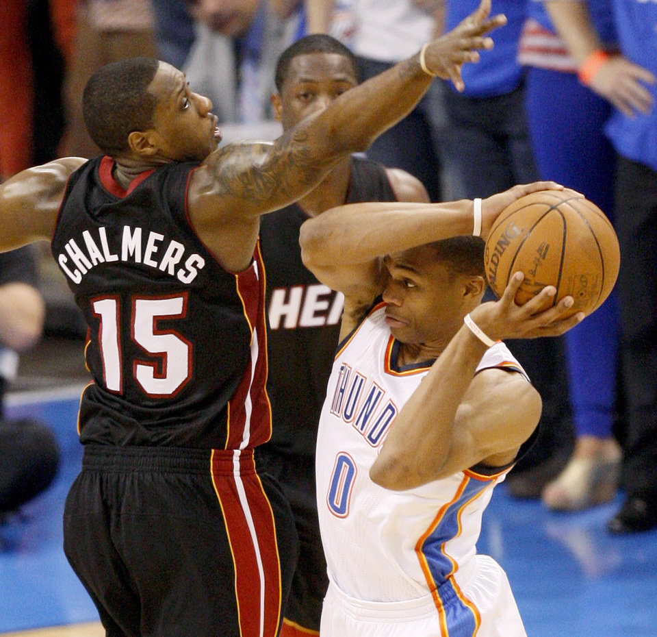 Oklahoma City's Russell Westbrook (0) passes around Miami's Mario Chalmers (15) during Game 2 of the NBA Finals between the Oklahoma City Thunder and the Miami Heat at Chesapeake Energy Arena in Oklahoma City, Thursday, June 14, 2012. Photo by Nate Billings, The Oklahoman