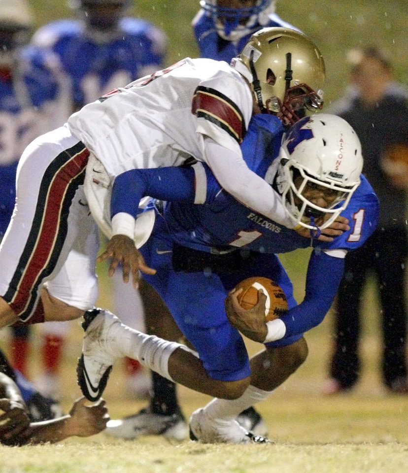 Photo - Millwood's Dametric Sanders is brought down by Lincoln Christian's Austin Grauer during a Class 2A high school football playoff game between Millwood and Lincoln Christian in Oklahoma City, Friday, Nov. 25, 2011. Photo by Bryan Terry, The Oklahoman