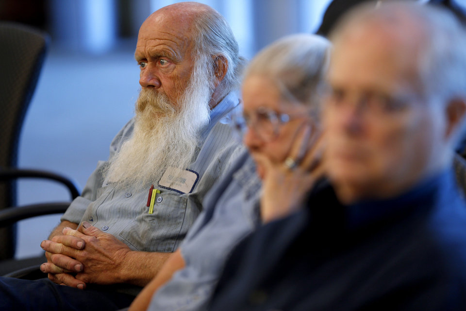 Photo - Mike Eble, of Midwest City, listens to Rep. Tom Cole, R-Moore, during a town hall meeting at Rose State College in Midwest City, Tuesday, September 3, 2013. Photo by Bryan Terry, The Oklahoman  BRYAN TERRY - THE OKLAHOMAN
