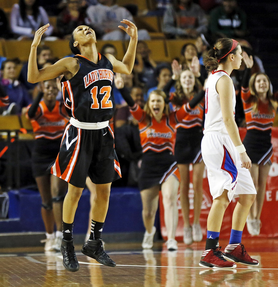 Booker T. Washington\'s Kaylan Mayberry (12) reacts after hitting a 3-point shot late in the Class 6A girls championship high school basketball game in the state tournament at the Mabee Center in Tulsa, Okla., Saturday, March 9, 2013. Booker T. Washington beat Bixby, 52-46. Photo by Nate Billings, The Oklahoman