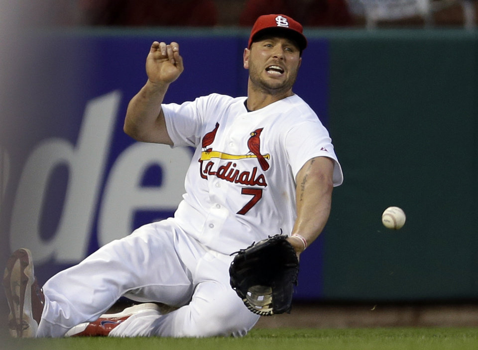 Photo - St. Louis Cardinals left fielder Matt Holliday cannot catch a ball hit by Arizona Diamondbacks' Tuffy Gosewisch for a single during the sixth inning of a baseball game Thursday, May 22, 2014, in St. Louis. (AP Photo/Jeff Roberson)