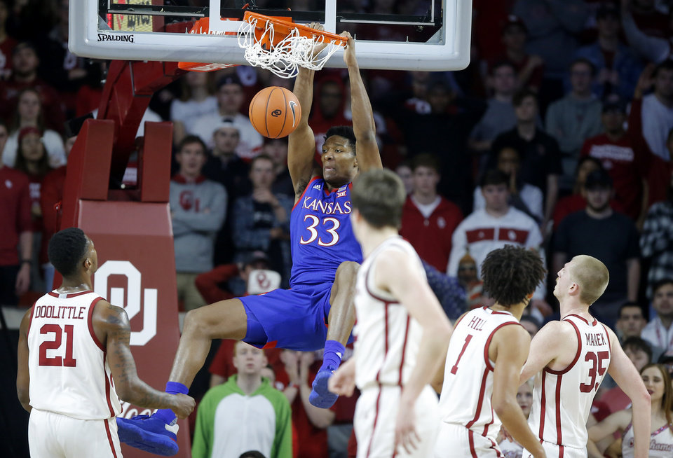 Photo - Kansas' David McCormack (33) dunks the ball during an NCAA college basketball game between the University of Oklahoma Sooners (OU) and the University of Kansas Jayhawks at Lloyd Noble Center in Norman, Okla., Tuesday, Jan. 14, 2020. Oklahoma lost 66-52.  [Bryan Terry/The Oklahoman]