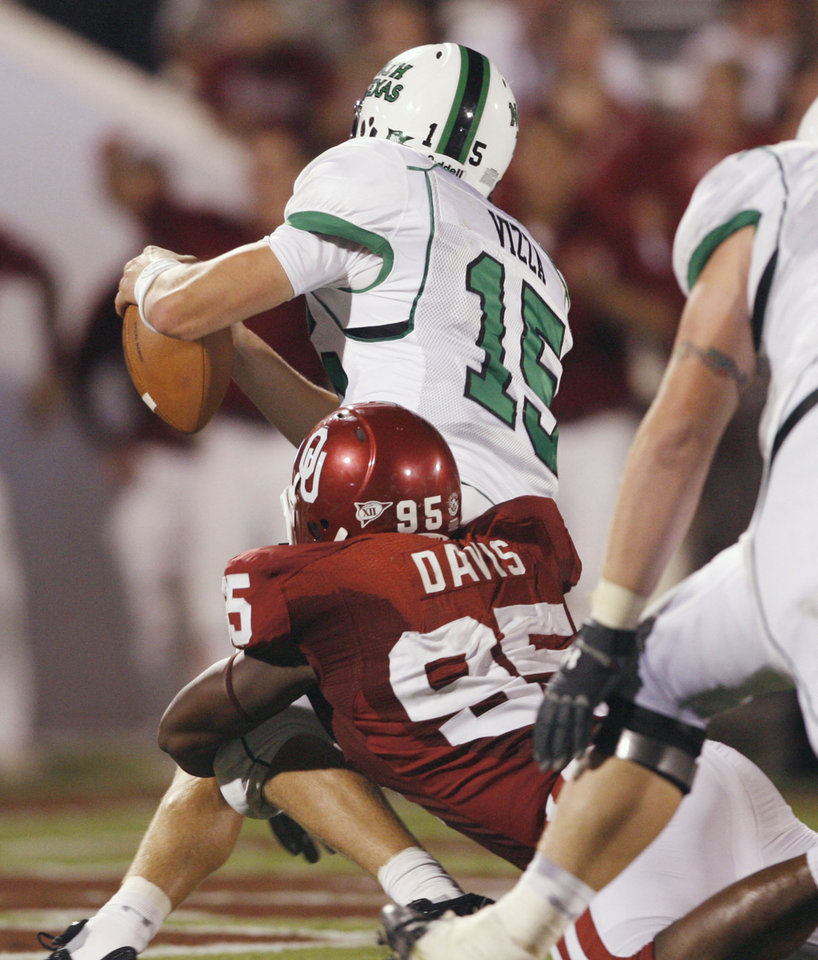 Photo - Alan Davis tackles quarterback Giovanni Vizza for a safety in the second half during the University of Oklahoma Sooners (OU) college football game against the University of North Texas Mean Green (UNT) at the Gaylord Family - Oklahoma Memorial Stadium, on Saturday, Sept. 1, 2007, in Norman, Okla.   By STEVE SISNEY, The Oklahoman