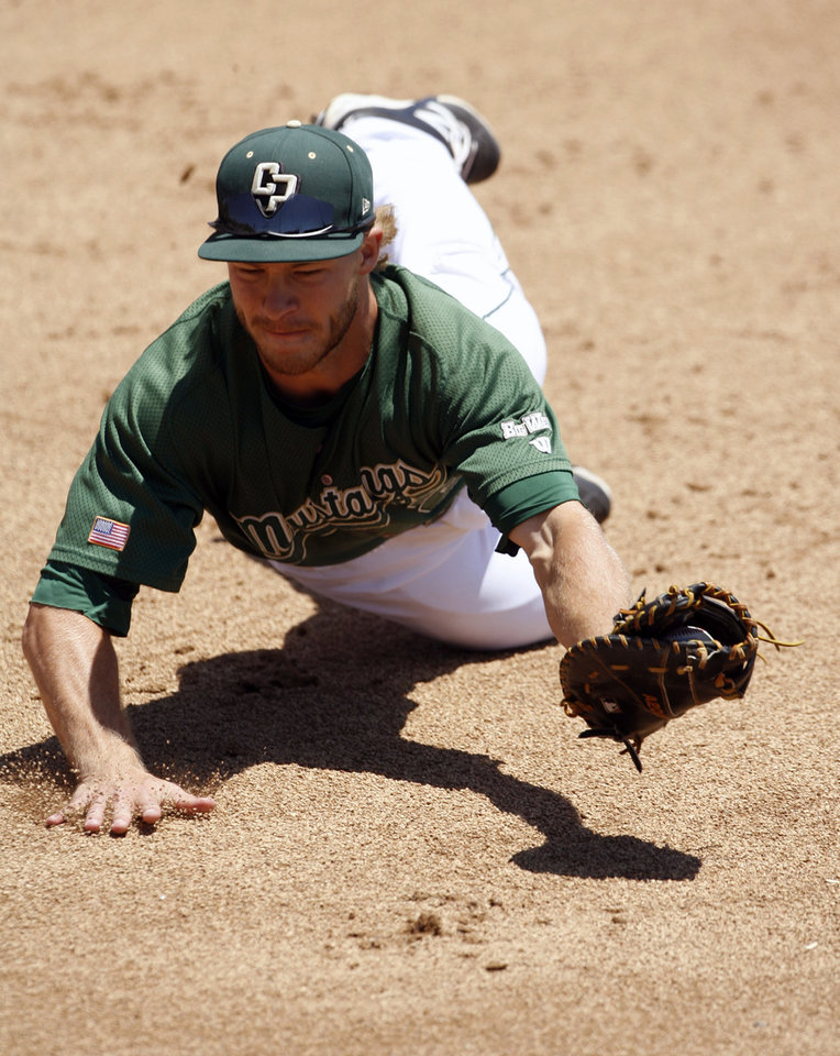 Photo - Cal Poly first baseman John Schuknecht makes a diving catch during the second inning of an NCAA college baseball tournament regional game against Sacramento State on Sunday, June 1, 2014, at Baggett Stadium at Cal Poly in San Luis Obispo, Calif. (AP Photo/Aaron Lambert)