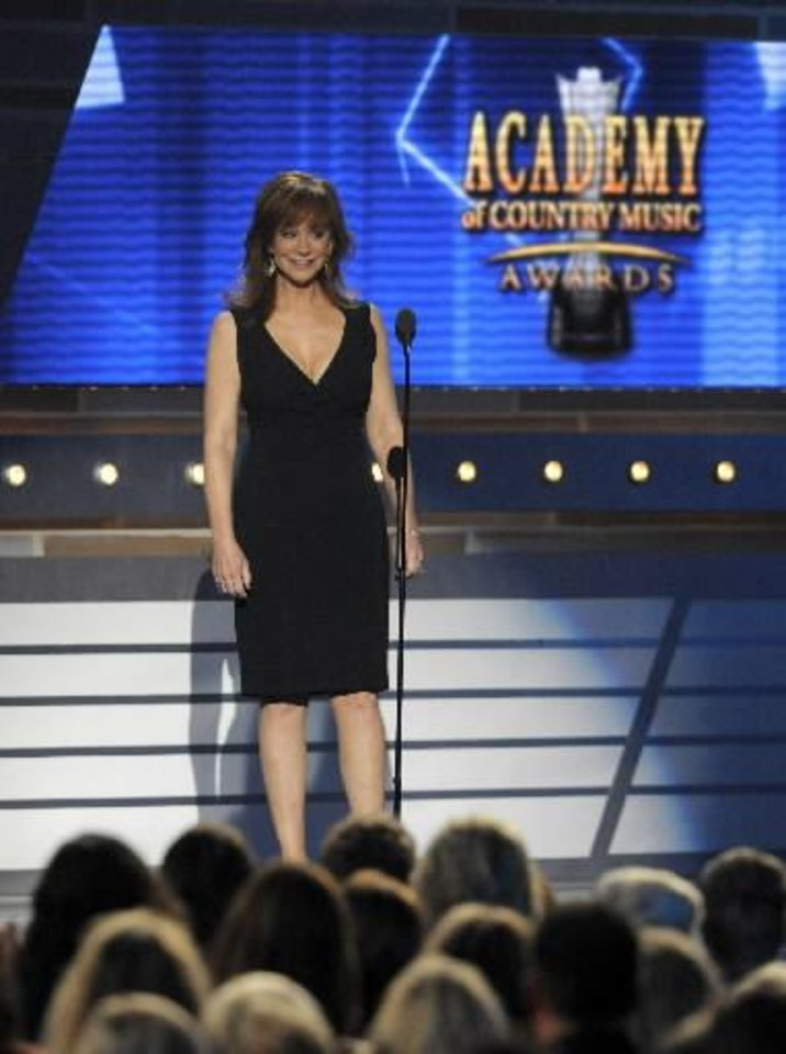 Reba McEntire introduces Garth Brooks and George Strait's Dick Clark tribute the 48th Annual Academy of Country Music Awards at the MGM Grand Garden Arena in Las Vegas on Sunday, April 7, 2013. (AP photos)
