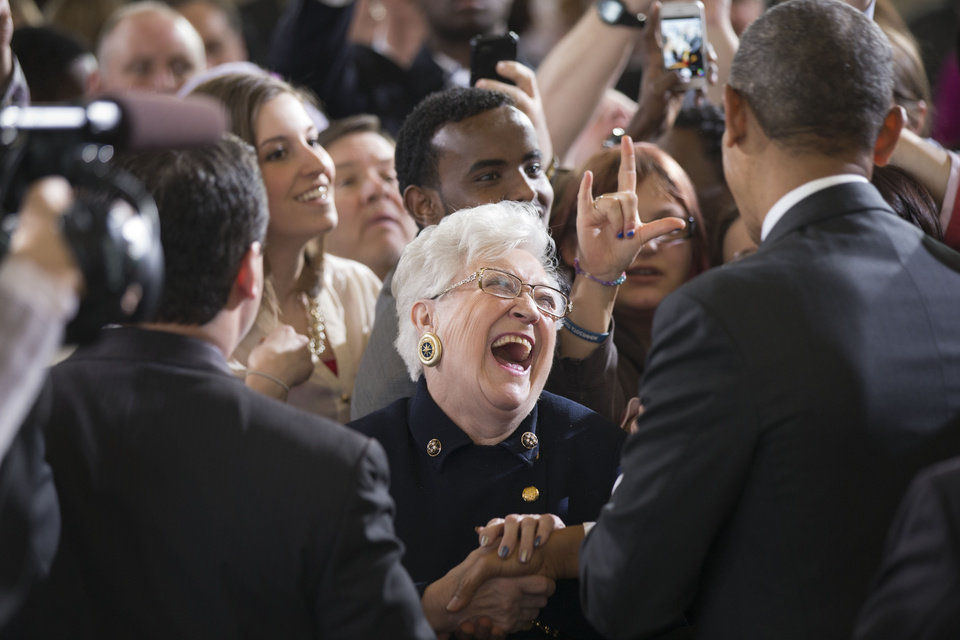 Photo - People in the crowd react as they are greeted by President Barack Obama after he spoke at Union Depot in St. Paul, Minn., Wednesday, Feb. 26, 2014, about a $300 billion transportation infrastructure plan. (AP Photo/Jacquelyn Martin)