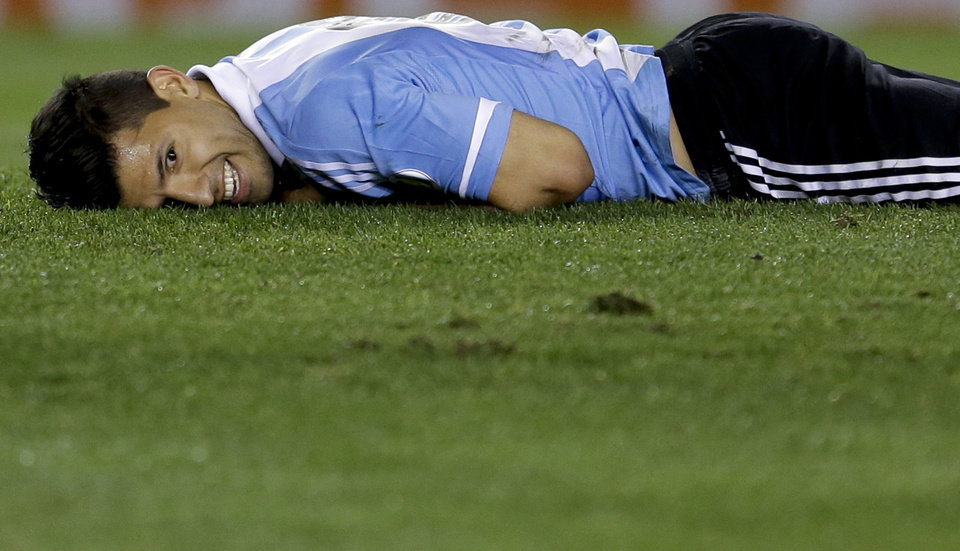 Photo - FILE - In this Oct. 11, 2013, file photo, Argentina's Sergio Aguero smiles after falling on the pitch during a 2014 World Cup qualifying soccer match against Peru in Buenos Aires, Argentina. (AP Photo/Natacha Pisarenko,File)