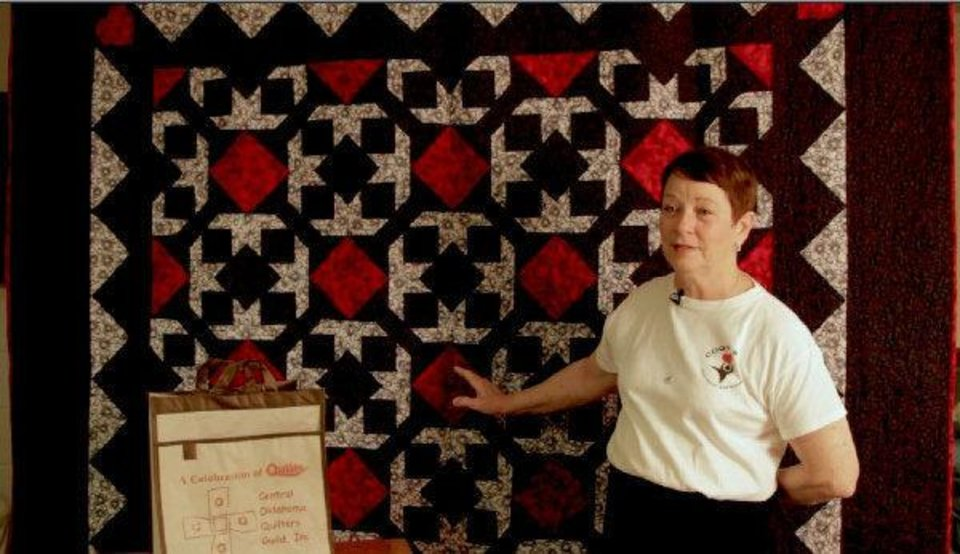 Photo - Georgann Giudice from the Central Oklahoma Quilters Guild talks about the upcoming Celebration of Quilts event. PHOTO BY DAVE MORRIS, THE OKLAHOMAN