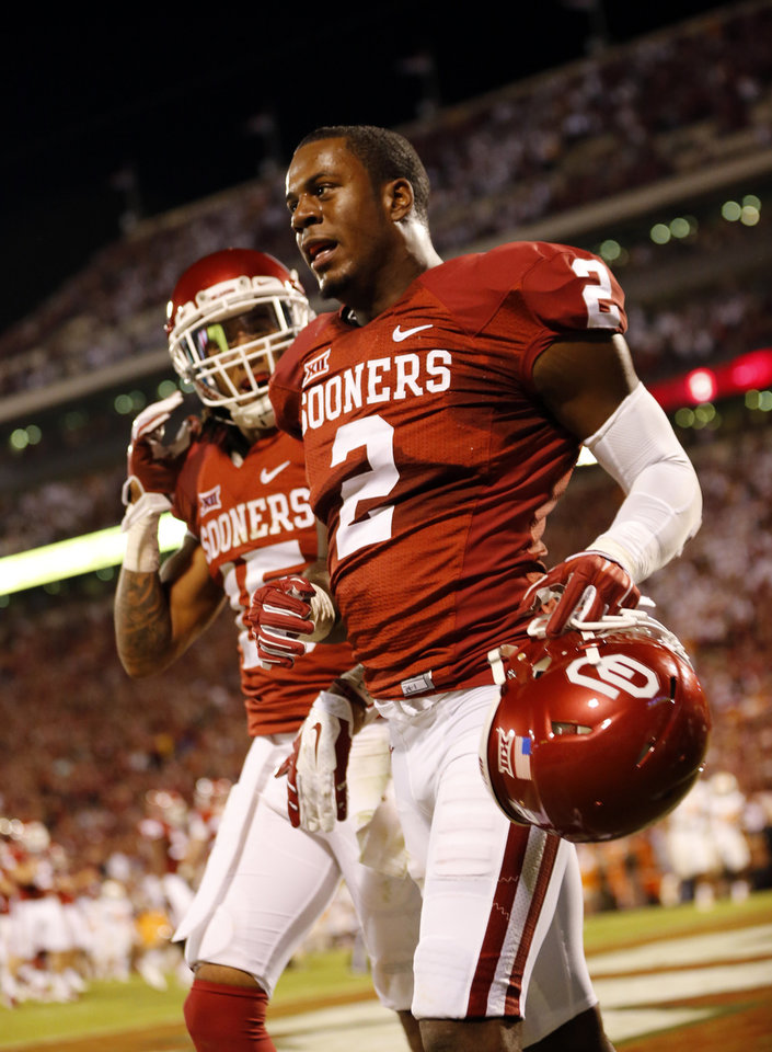 Photo - Oklahoma's Julian Wilson (2) is greeted in the end zone after a 100 yard interception and touchdown return during the second half of a college football game between the University of Oklahoma Sooners (OU) and the Tennessee Volunteers at Gaylord Family-Oklahoma Memorial Stadium in Norman, Okla., on Saturday, Sept. 13, 2014. Photo by Steve Sisney, The Oklahoman