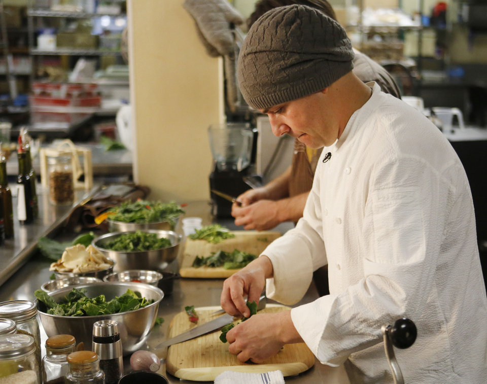 Photo - Above: Chef Guy Romo prepares a salad at the Urban Agrarian Market in Oklahoma City. Below: Romo's creation.