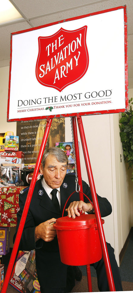Ernie Potter, facilities manager, checks the lock on a Salvation Army red kettle at the Central Oklahoma Area Command for The Salvation Army in Oklahoma City. The organization�s 2012 holiday donation drive starts in November.  Photo by Paul B. Southerland, The Oklahoman