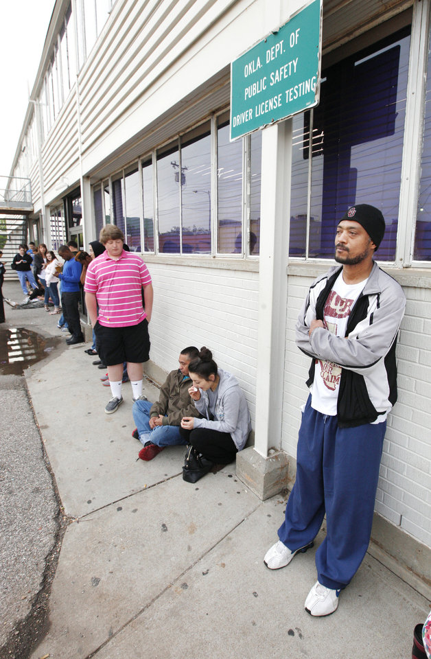 Photo - Jimmy Ezell, far right, from Okla. City, waits in line for the Okla. Department of Public Safety driver license testing facility to open in downtown Edmond Friday, May 10, 2013.  Photo by Paul B. Southerland, The Oklahoman
